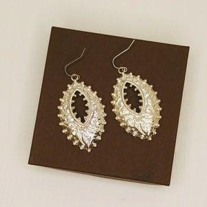 Silver tone boho style hook drop earrings.